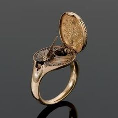 blackpaint20: A rare 16th century gold sundial and compass ring, possibly German, The hinged oval bezel designed as a seal and engraved wit...