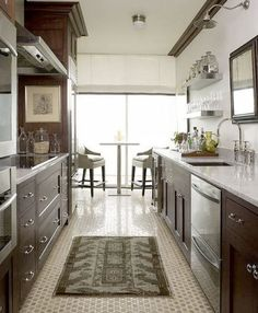 beautiful galley kitchen - love the floor tile