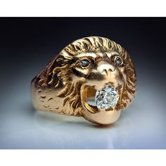 A Vintage Gold and Diamond Lion Ring with a Russian Jewish provenance made in St. Petersburg between 1908 and 1917 The gold ring is finely modeled as the h