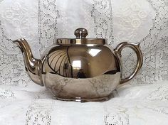 """This is a very beautiful Silver Luster Teapot made in England by the Sadler Ware Co. Made in the late 1800's early 1900's... This tea pot has no chips, cracks or crazing... It stands 5"""" tall and is 8.5"""" from spout to handle..."""