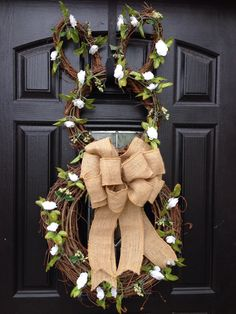 DIY Bunny Wreath with burlap bow. Still need to add a big flower to her head :)