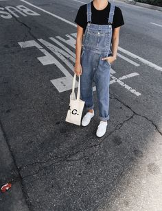 Comme des Garcons heart tee, A.P.C. bag and sneakers & vintage dungarees. Via Mija