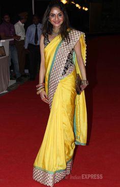Esha and Ahana's aunt Madhoo in a vibrant yellow sari with a black brocade corset blouse at Ahana Deol and Vaibhav Vora's sangeet ceremony.