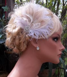 Ivory white champagne bridal hair fascinator rhinestone jewel elegant wedding hair clip, feather hair clip -ship ready. $48.00, via Etsy.