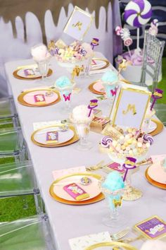 Take a look at the impressive table settings full of fabulous candy themed party food at this Willy Wonka birthday party. See more party ideas and share yours at CatchMyParty.com #catchmyparty #partyideas #4favoritepartiesoftheweek #willywonka #willywonkaparty #charlieandthechocolatefactory #charileandthechocolatefactoryparty #candyland #willywonkatablesettings