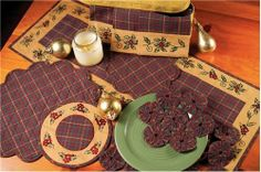 "Traditions 36"" Table Runner by Victorian Heart Co., Inc.. $14.95. 100% cotton. 36"" Table Runner. For best results, machine wash gentle, line dry.. The Traditions Collection combines embroidered pieces, plaid quilted pieces, and yo-yo pieces to make a timeless statement in your home this holiday season. Coordinating tabletop and holiday décor items also available."