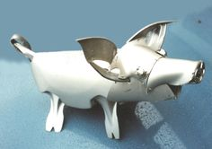 A cute hubcap piglet to see us into Monday morning... Hubcap Creatures