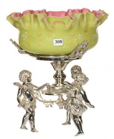 CASED GREEN SATIN WITH PINK INTERIOR WITH ENAMEL FLORAL DECOR - SET ON ELABORATE WILCOX SILVERPLATE THREE CHERUB BASE