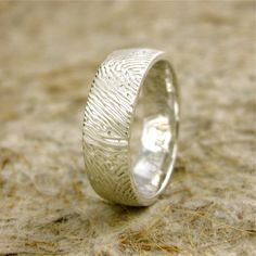 Fingerprint wedding band. -- This will be my ring with his fingerprints carved out of the metal... awesome idea!