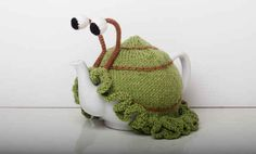 Knitted green snail tea cosy:
