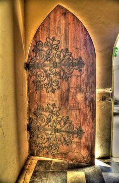 ironwork on wooden doors. perhaps there is a way to have beautiful ironwork as…