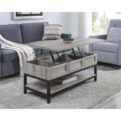 Ameriwood Home Barrett Modern Farmhouse Lift top Sonoma Oak Coffee Table. Use this coffee table in your living room and lift your laptop, food or drinks up where it feel comfortable while sitting. Lift Up Coffee Table, Unique Coffee Table, Oak Coffee Table, Modern Coffee Tables, Coffee Table With Storage, My Living Room, Living Room Furniture, Kellys Furniture, Pallet Furniture