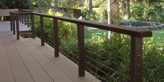 Photo Gallery of Ultra-tec stainless steel cable railing products used in cable deck railing with wood or metal posts