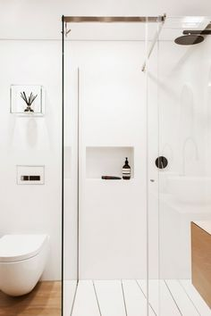 Bathroom - Minimalist And Elegant Glass Shower Space Inside The Clean Simple Lines Bathroom With Black Faucet And White Wall: An Award Winning Simple and Minimalist Bathroom Design Ideas