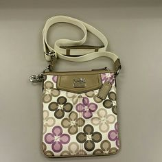 Authentic Coach crossbody sling purse Pretty Coach crossbody sling purse. Adjustable strap with normal wear (has some light spots on strap that can be cleaned with a lil soap and water and toothbrush) leather on front has a few spots on it. Beautiful for the upcoming spring! Coach Bags Crossbody Bags
