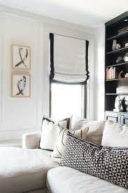White roman shade with black border. White sectional sofa with black and white pillows. Living Room White, New Living Room, Living Room Sofa, Small Living, White Sectional Sofa, White Sofas, Monochromatic Living Room, Black And White Pillows, Family Room Design