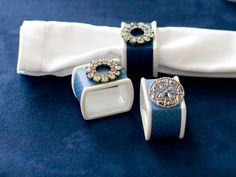 This is a great DIY idea for your wedding!  Elegance is in the details: Vintage jewelry dresses up napkin rings. Wrap plain white napkin rings with decorative paper or ribbon, securing with tape. Attach a piece of jewelry with a dot or two of hot glue.