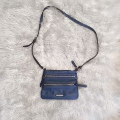 Nine West Crossbody Bag Nine West crossbody bag with two exterior zippers in bright blue. Wore purse for a week in Spain. Perfect bag for travel! Ships from a smoke free home. Open to offers 😊 Nine West Bags Crossbody Bags
