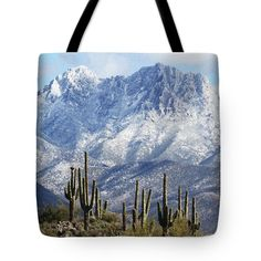 Saguaros At Four Peaks With Snow Tote Bag by Tom Janca.  The tote bag is machine washable, available in three different sizes, and includes a black strap for easy carrying on your shoulder.  All totes are available for worldwide shipping and include a money-back guarantee.