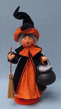 <p> Annalee Doll Description: Open eyes, mouth expression may vary, white hair, orange and black hat and dress, holds broom and cauldron, orange base.</p>