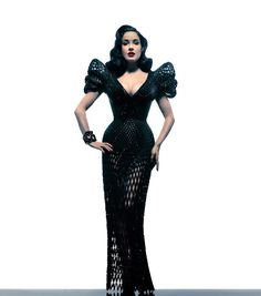 Burlesque performer Dita Von Teese modeled the very first fully articulated 3D-printed dress at an unveiling party earlier this week at Ace Hotel New York. The spectacular garment is made of 17 individually printed pieces with 3,000 articulated joints.
