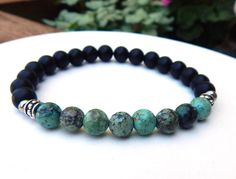 African turquoise mens beaded bracelet made with Rustic African Turquoise surrounded by smooth Matte Black Onyx. Gemstone bracelets for men. Many sizes. Handmade jewelry for men. Mens Gold Jewelry, Black Hills Gold Jewelry, Black Jewelry, Turquoise Jewelry, Turquoise Bracelet, Beaded Jewelry, Man Jewelry, Turquoise Gemstone, Handmade Jewelry