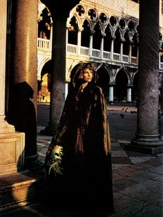 Julie Christie in a Fortuny velvet hooded cape, photographed by Alfa Castaldi for British Vogue, Piazza San Marco, Venice, July 1973
