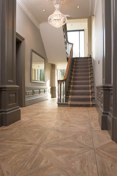 The Parquet range of porcelain wood effect tiles takes its inspiration from traditional challis found in the Swiss Alps. This inspiration is evident in subtle nuances that mimic the various degrees of aging larch wood. Parquet Tiles, Wood Parquet, Parquet Flooring, Wooden Flooring, Parquet Versailles, Wood Floor Design, Wood Effect Tiles, Hall Flooring, Tiled Hallway