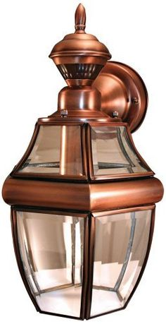 "Motion Sensor 14 1/2"" High Brushed Copper Outdoor Light by Universal Lighting and Decor. $99.91. This carriage-style outside wall lamp offers great looks, plus the convenience of a built-in motion detector and dusk-to-dawn sensor. A handy security feature around garages and patios, the motion sensor has a 150 degree, 30 foot range. The design also comes with the Dual Brite two-level lighting feature, which brightens the light output from the light when motion is detected."