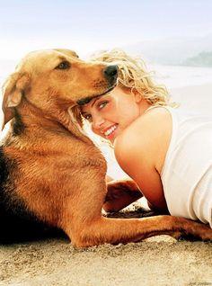 Charlize Theron y su perro