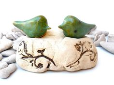Wedding cake topper Love is solid as a rock - ceramic love birds in a color of your choice