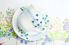 hand painted china cup and saucer in pretty by tillyandarthur