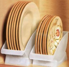 Dinner Plate Cradles Instead of stacking your heavy plates on top of each other, consider investing in a few dinner plate cradles to keep them upright and easy to pull out of the cupboard. These are also nice for drying plates next to the sink.