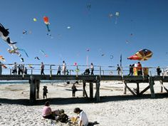 Semaphore's white sands, family-friendly shallows and colourful foreshore make for a classic Adelaide beach escape.
