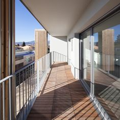 Image 29 of 46 from gallery of Social Housing + Shops in Mouans Sartoux / Comte & Vollenweider. Photograph by Milèle Servelle Alcacer Do Sal, Wood Facade, Council House, Social Housing, Small Buildings, Architecture Design, Modern Design, Stairs, Gallery