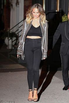 Chrissy Teigen wearing AYR Hi-Rise Skinny Jeans in Jet Black