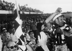 Stirling Moss celebrates victory in the Argentine Grand Prix | Formula 1 photos | ESPN F1 1958