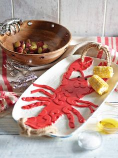 Lobster Platter. Raised Lobster details fill and accent our serving platter. Jute rope handles provide additional nautical appeal.