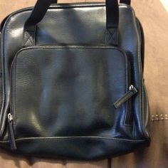 Black bag with plenty of compartments No name black faux pebbled leather look. One front pocket does not zip. Middle compartments zip closed with more smaller pockets and zipper sections. Another zipper compartment on the backside (first pic) with pen holder elastic, elastic pocket for phone, credit card & ID slots as well. Perfect for travel! no name Bags