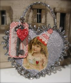 Heart Strings altered art ornament by Mary Charles
