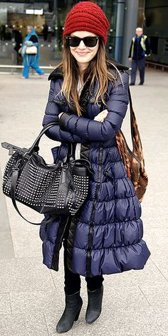 Rachel Bilson in a Burberry puffer with a cherry beanie on top, an edgy satchel on one arm and Tylie Malibu tote on the other.