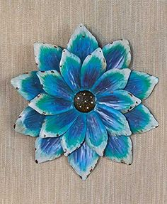 Give any room a vibrant, springtime look year 'round with this Handpainted Metal Wall Flower. The detailed brush strokes lend a natural look, while its petals add depth to your wall. Use it to add color to a room or brighten a garden wall outdoors.