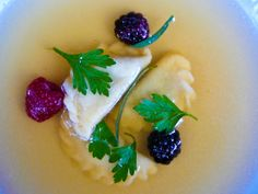 goose consomme with smoked goose ravioli