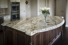 Learn all you need to know about granite, from installing, cost, cleaning, removing stains, and even picking out the perfect sink to accompany it!