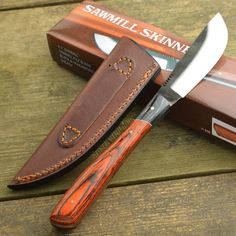 """Sawmill skinner 8 3/8"""" overall fixed blade knife. 3 1/2"""" high carbon stainless file blade. Full tang. Brown pakkawood handles with black wood trim. Brown leather belt sheath."""