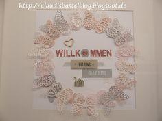 Ein neuer Bilderrahmen vom Schweden schön dekoriert :-)  u.a. mit den Thinlits und Framelits Schmetterlinge, dem Stempelset Herzlich Willkommen, Strasssteinen, Washi-Tape, etc.