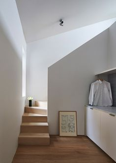 Pale oak staircases ascendto a pair of mezzanine floors set in the rafters of thisMelbourne residence, which has been renovated by Wilson Tang