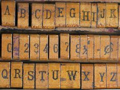 Old wooden ABC and number stamps