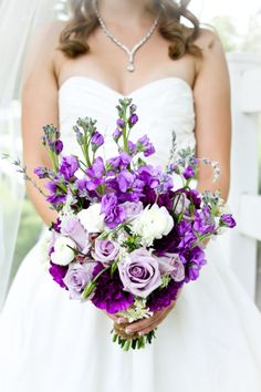 Purple wedding bouquet ~~ I'm not wild about carrying flowers, but these are pretty!
