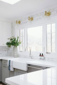 Kitchen Countertop and Backsplash. My favorite detail in this kitchen is the solid white quartz countertop paired with the calcutta marble backsplash that goes up to the ceiling. #backsplash #countertop #whitequartz #kitchen #backsplashtotheceiling Studio McGee